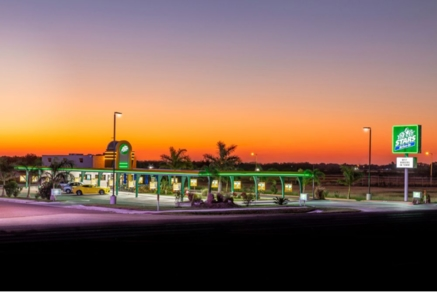Stars Drive-in with green awning, in evening time